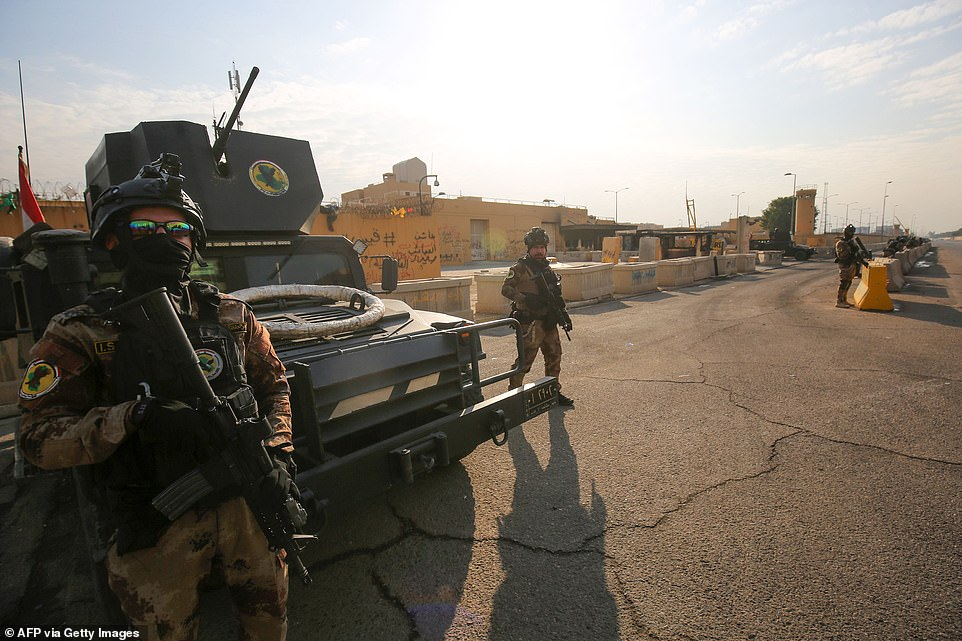The US embassy siege by pro-Iran protesters in Baghdad lasted just over a day, but analysts warn it could have lasting implications for Iraq's complex security sector and diplomatic ties (pictured: specialist Iraqi forces outside the complex on Thursday)