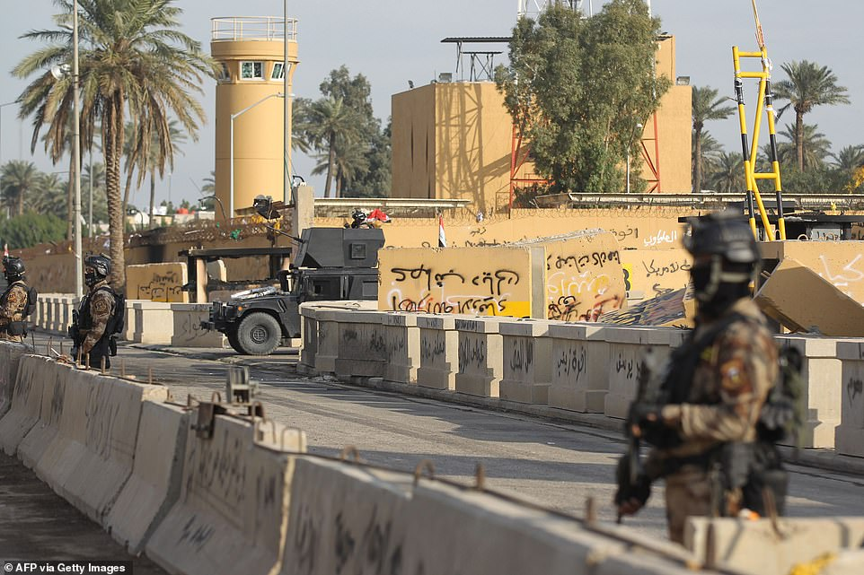 Iraqi counter-terrorism forces stand guard in front of the US embassy in the capital Baghdad on Thursday. Riots outside the embassy have highlighted Baghdad's precarious balance between its allies in Washington in Tehran