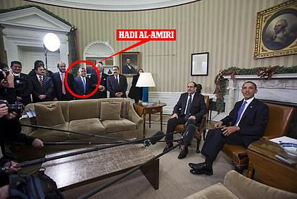 President Obama sitting alongside Iraq's then-Prime Minister Nouri al-Maliki in the Oval Office of the White House in December 2011. Hadi al Amiri, who led a pro-Iran siege on the US embassy in Baghdad on Tuesday stands behind the sofa wearing a blue tie as part of Maliki's delegation
