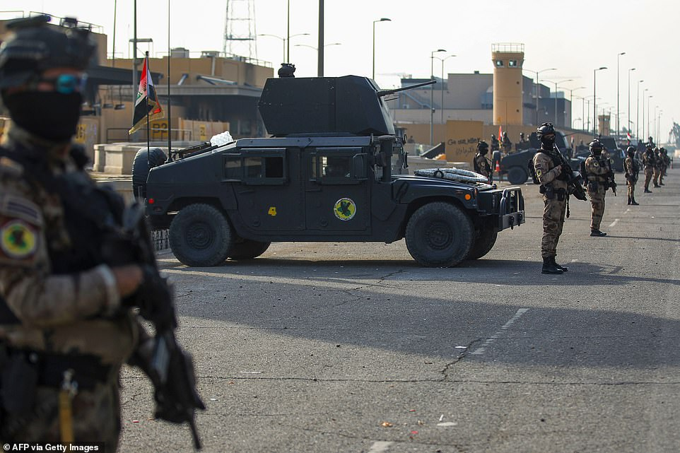 Iraqi counter-terrorism forces stand guard in front of the US embassy in the capital Baghdad on Thursday