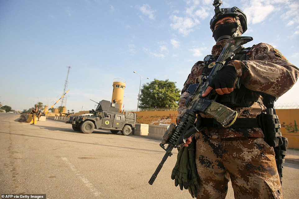 The ease with which the rioters breezed past US-trained forces demonstrated the dominance of the PMF in Iraq (pictured: counter-terror forces outside the gates today)