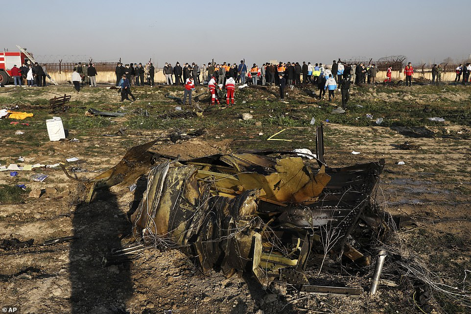 Debris is seen from a Ukrainian plane which crashed as authorities work at the scene in Shahedshahr